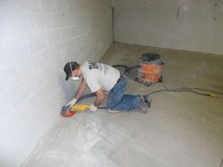 Hand Grinding Edges of Concrete Floor