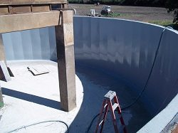 During surface preparation and application of base coat to reservoir
